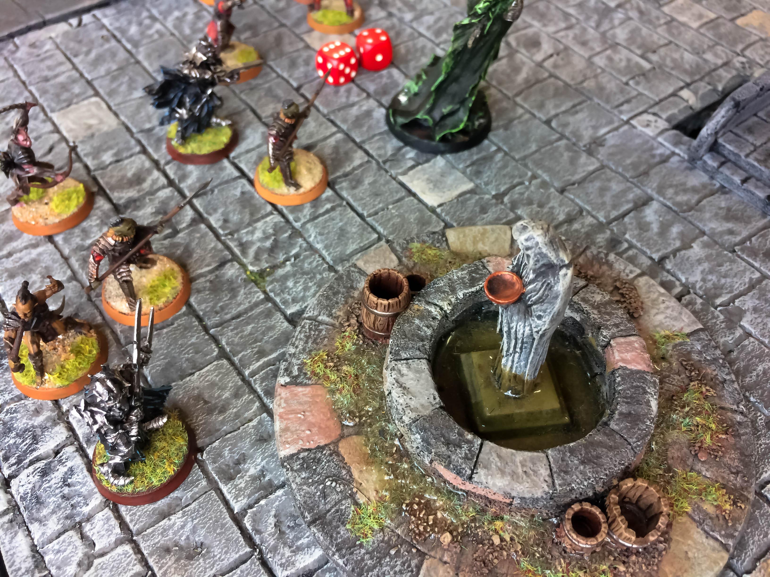 Cenário de wargame de Senhor dos Anéis com miniaturas